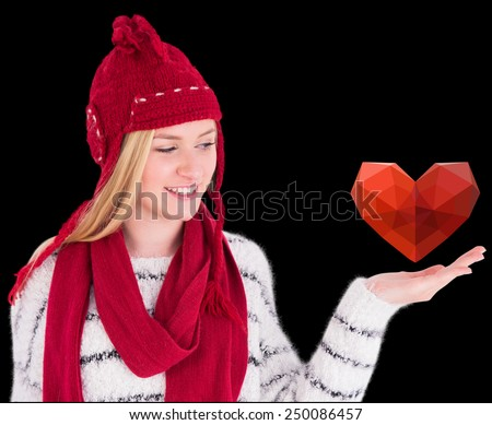 Festive blonde presenting with hand against black - stock photo