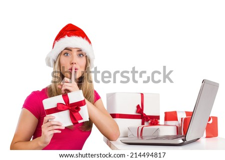 Festive blonde shopping online with laptop on white background - stock photo