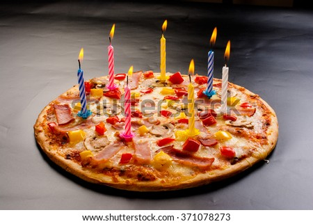 Festive candles pizza with ham, mushrooms, cheese and sweet pepper top view - stock photo