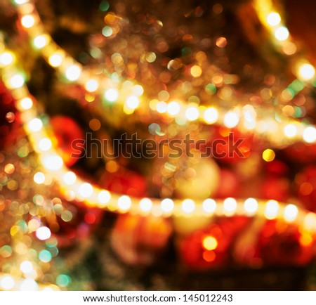 Festive Christmas background as a sparkly bokeh light effect of defocused decorated xmas tree fragment - stock photo
