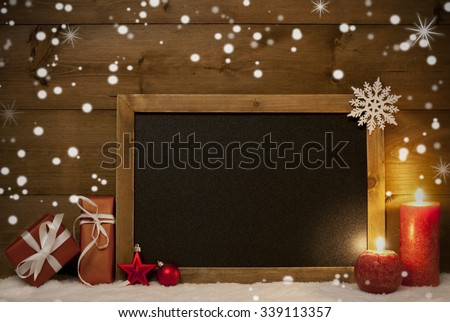 Festive Christmas Card With Chalkboard, Red Gifts Or Presents, Christmas Balls, Snowflakes And Candles. Christmas Decoration With Rustic, Vintage Brown Wooden Background. Copy Space For Advertisement - stock photo