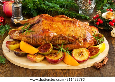 Festive Christmas duck baked with apples and figs. - stock photo