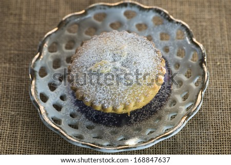 Festive Christmas mince pie on a plate - stock photo