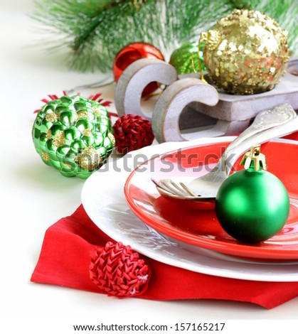 Festive Christmas table setting with decorations - stock photo