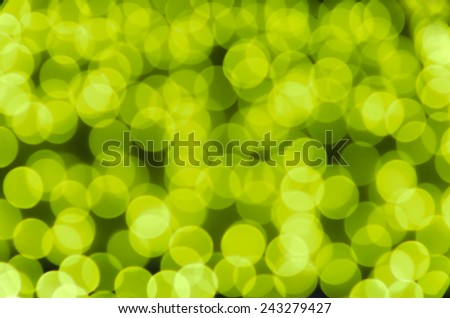 Festive colored glowing abstract circular bokeh cold yellow green background. Best for greeting card, web  banner. - stock photo