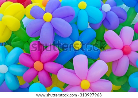 Festive composition of inflatable balloons in the form of multicolored flowers - stock photo