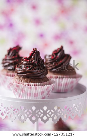 Festive decorated chocolate cupcakes - stock photo