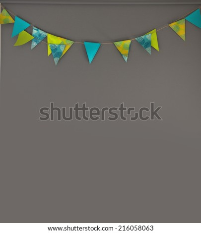 Festive decoration - colorful festive flags gray background decoration - colorful flags in front of gray background - stock photo