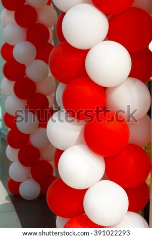 Festive decoration of balloons of red and white - stock photo