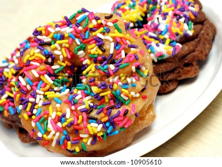 Festive donuts with rainbow sprinkles. - stock photo