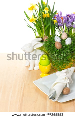 festive easter table setting with bunny and eggs decoration on white background. selective focus - stock photo