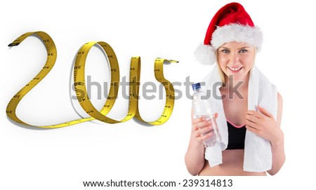 Festive fit blonde smiling at camera against 2015 tape - stock photo