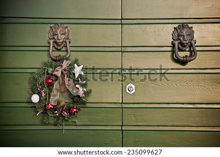 Festive garland Christmas hanging on a old wooden door  - stock photo