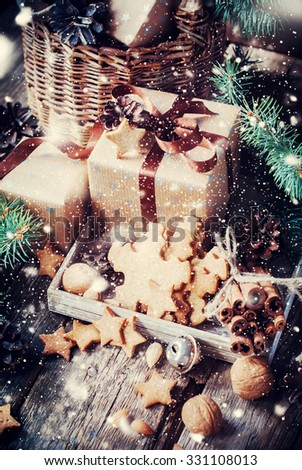 Festive Gifts with Boxes, Cookies and Nuts. Vintage Style with Drawn Snow - stock photo
