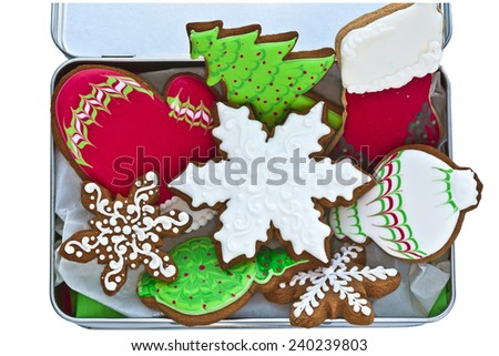 Festive iced ginger bread cookies in a tin box. - stock photo