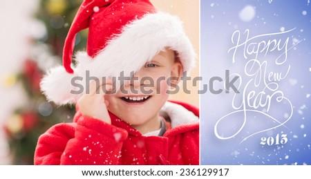 Festive little boy smiling at camera against purple vignette - stock photo