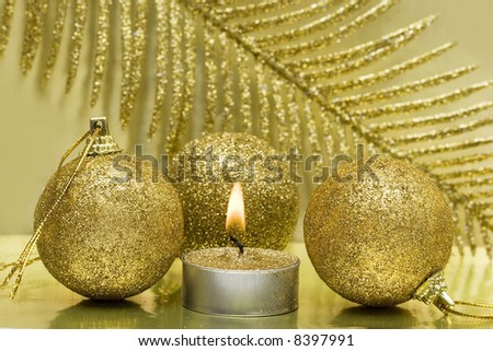 festive new-year candle and Christmas balls - stock photo