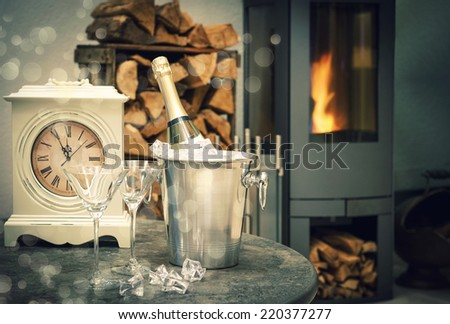 festive New Year's home interior with champagne, antique clock and fireplace. selective focus. vintage style dark toned picture with lights effect - stock photo