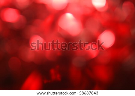 Festive red background bokeh of glare - stock photo