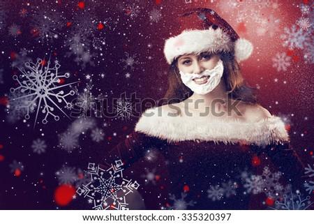 Festive redhead in foam beard against snow - stock photo