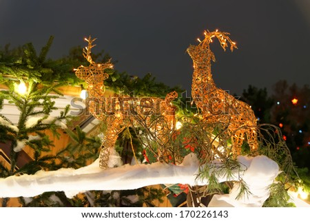 Festive reindeer decorated with lights - stock photo