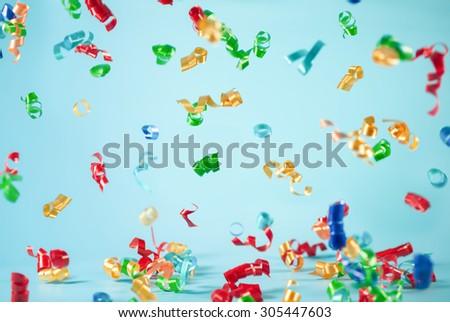 Festive ribbon flying on blue background - stock photo
