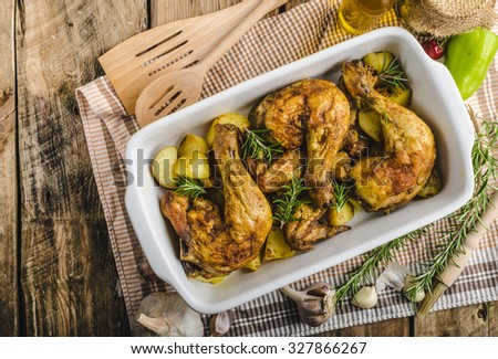 Festive slowly roasted chicken with garlic and herbs - stock photo