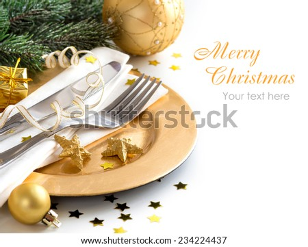 Festive table setting with golden bauble and plate - stock photo