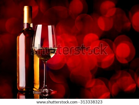 Festive white wine on a red background - stock photo