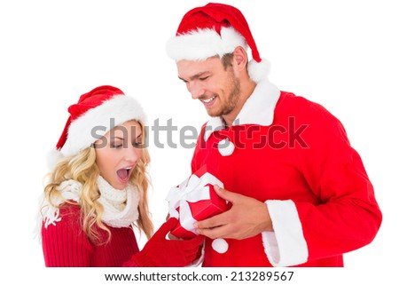 Festive young couple exchanging presents on white background - stock photo