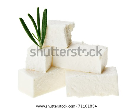 Feta cheese cubes with rosemary twig, isolated on white - stock photo