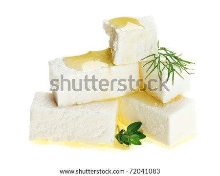 Feta cheese cubes with thyme twig and oil drops, isolated on white - stock photo