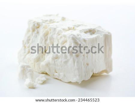 Feta cheese isolated on white - stock photo