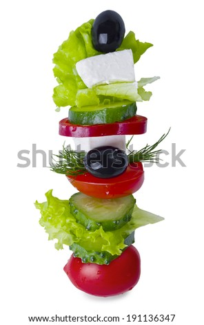 Feta cheese, olive and vegetables on a spit - stock photo