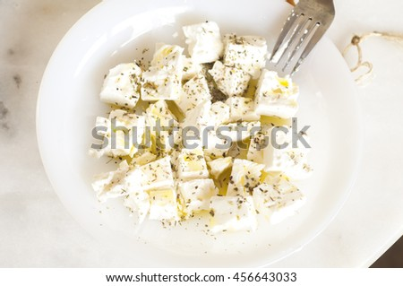 Feta cheese with oil and spice  - stock photo