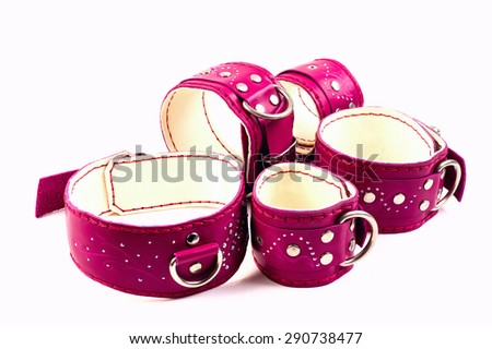 Fetish Hand cuffs, leg cuffs and collar a made of pink leather and rhinestones - stock photo