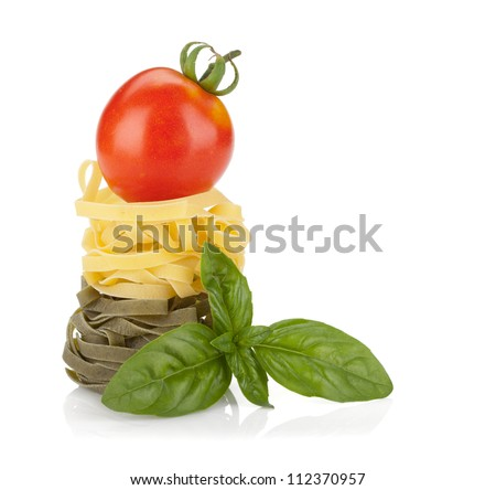 Fettuccine nest pasta with tomato cherry on top. Isolated on white background - stock photo