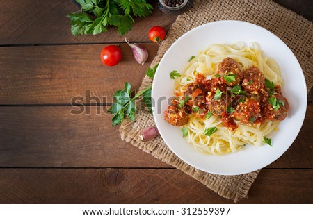 Fettuccine Pasta with meatballs in tomato sauce. Top view - stock photo