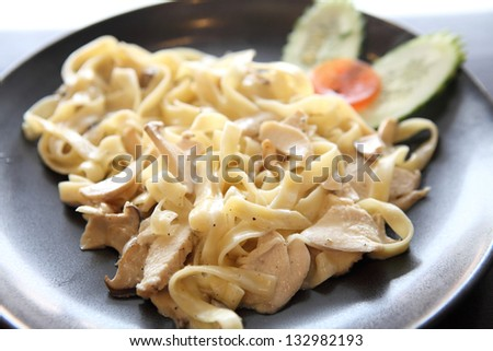 fettuccine with chicken and cream - stock photo