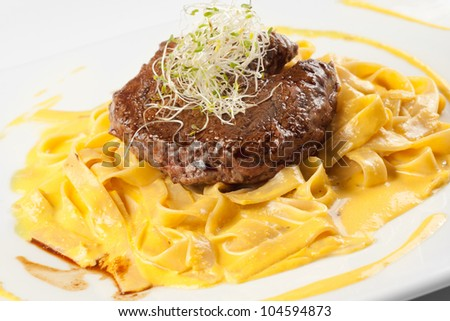 fettuccine with spicy sauce and beef - stock photo