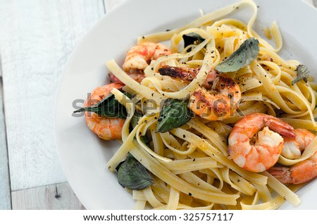 Fettuccini with shrimps and fresh basil leaves  - stock photo