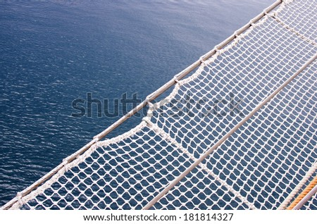 fety net and sea background on old boat - stock photo