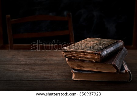 Few books on wooden table - stock photo