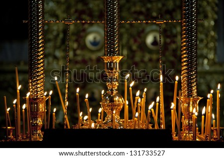 Few candles in a church. Joseph-Volokolamsk Monastery for men in Moscow suburbs - stock photo