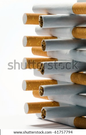few cigarettes lying on a white background - stock photo