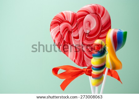 Few colorful lollipops over cyan background. - stock photo