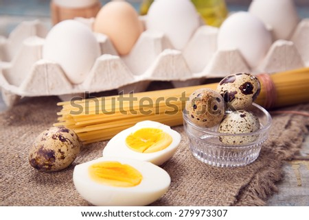 few different eggs with macaronis and oil in a studio - stock photo