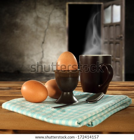 few eggs and brown mug  - stock photo
