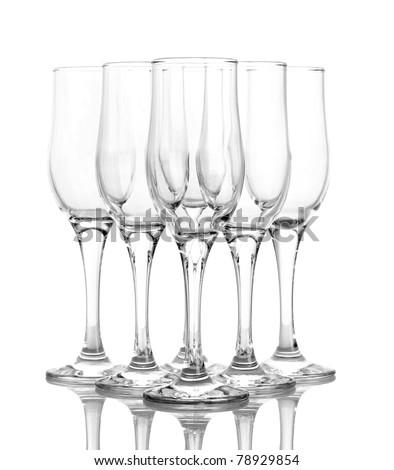 Few empty wine glasses on blue background - stock photo
