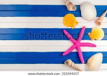 Few marine items on a wooden colored background. - stock photo